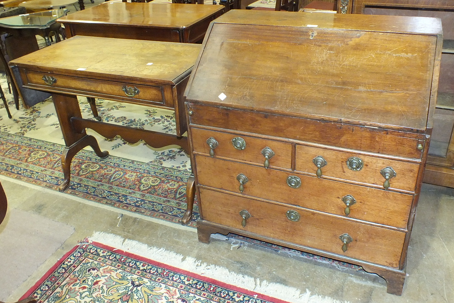 Lot 15 - A 19th century mahogany bureau, the rectangular top above a fall front revealing pigeon holes,