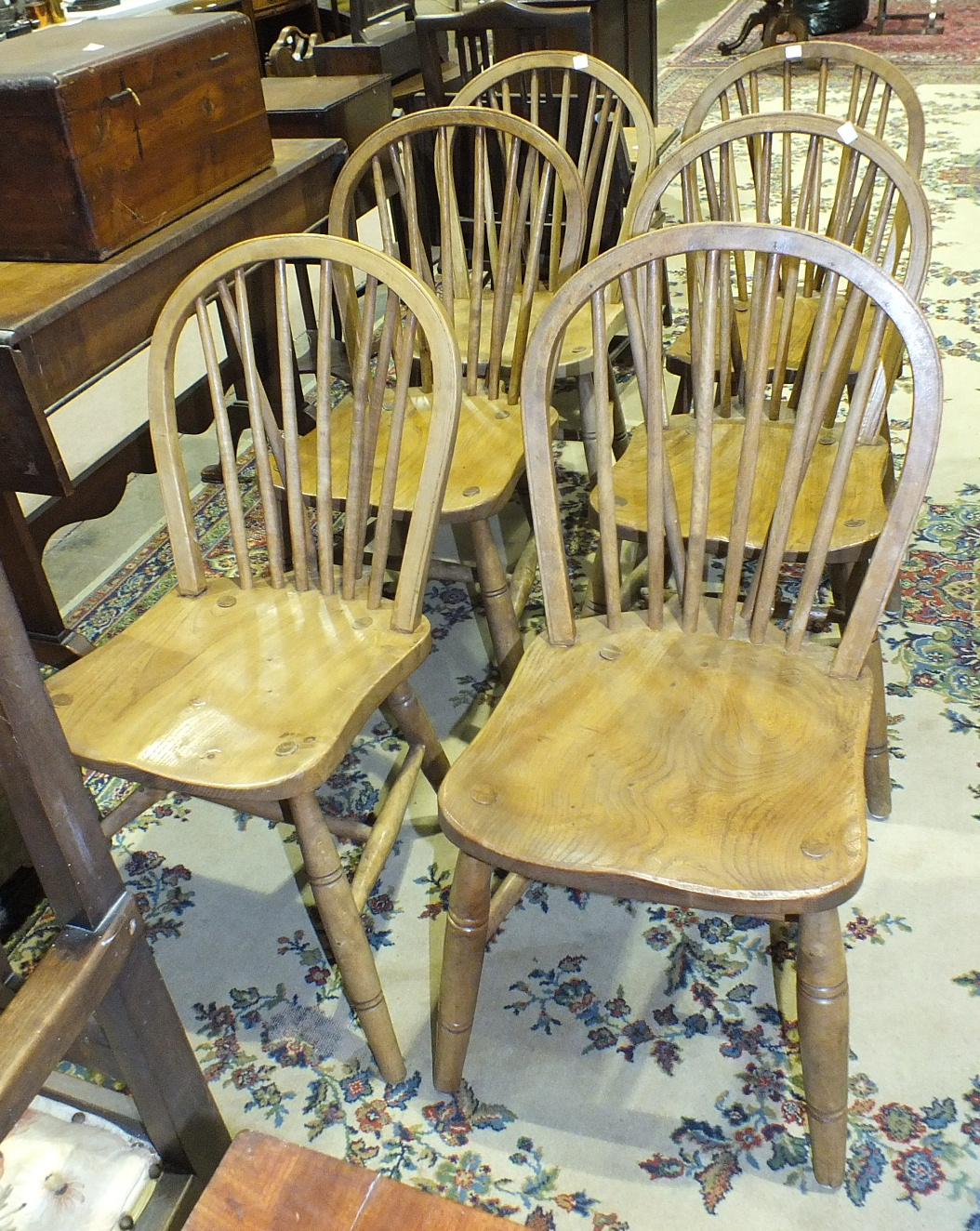 Lot 14 - A set of six elm and beech stick-back kitchen chairs, on turned legs with H-stretcher, (6).
