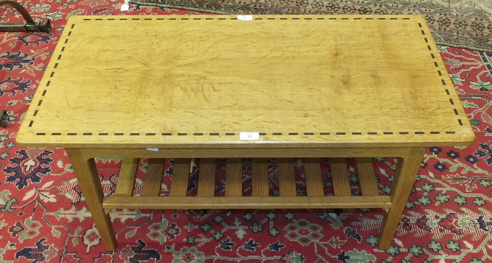 Lot 35 - A craftsman-made oak two-tier coffee table, the rectangular inlaid top on chamfered square legs
