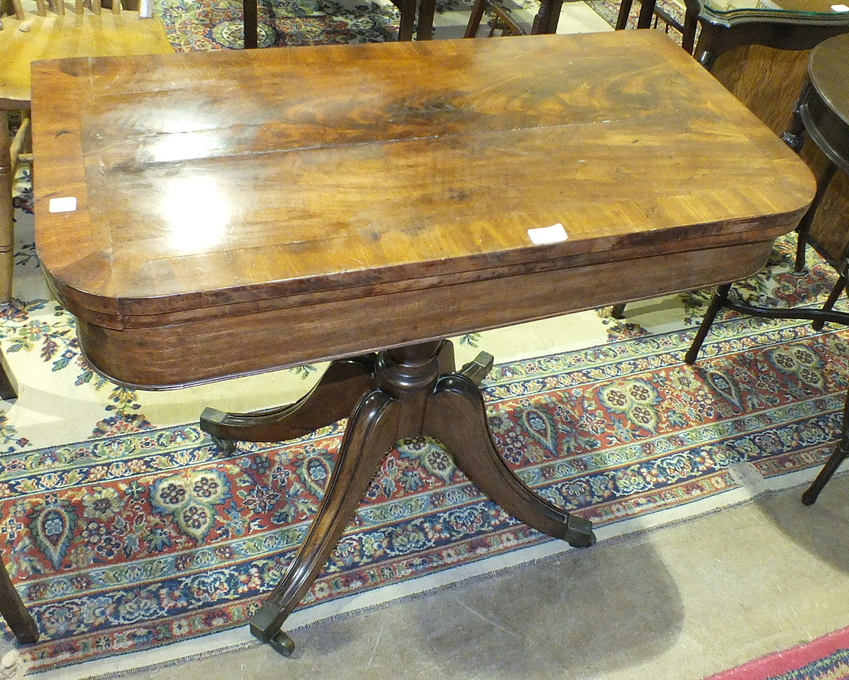 Lot 66 - An early-19th century mahogany fold-over card table, (top split), on quadruped base, 94cm wide.