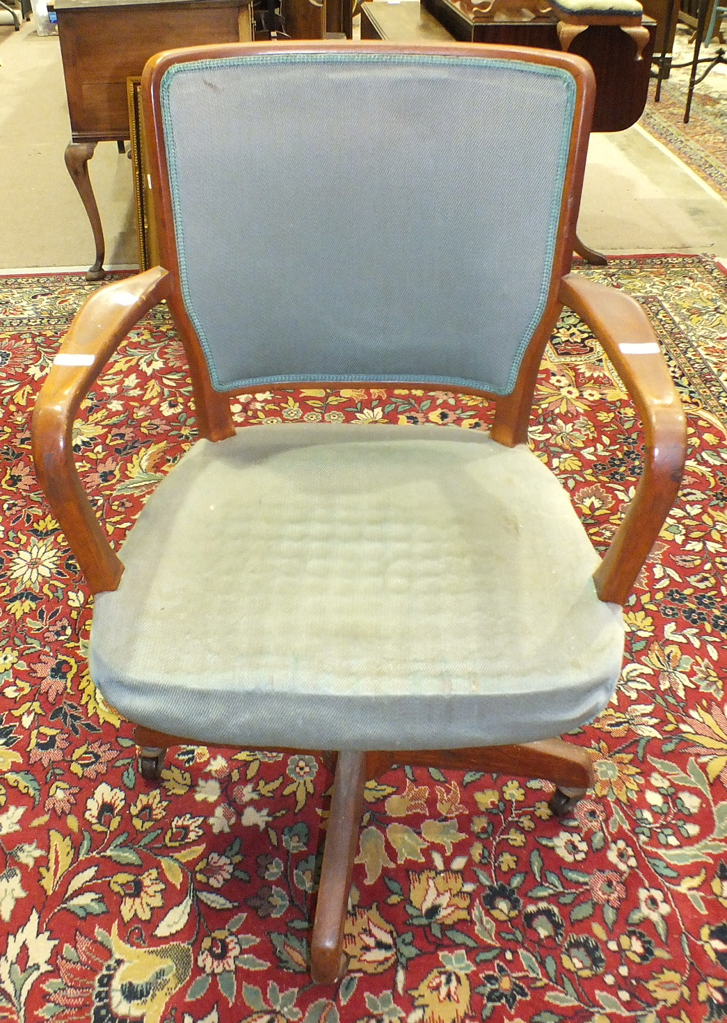 Lot 65 - A mid-20th century hardwood swivel office armchair with upholstered back and seat.