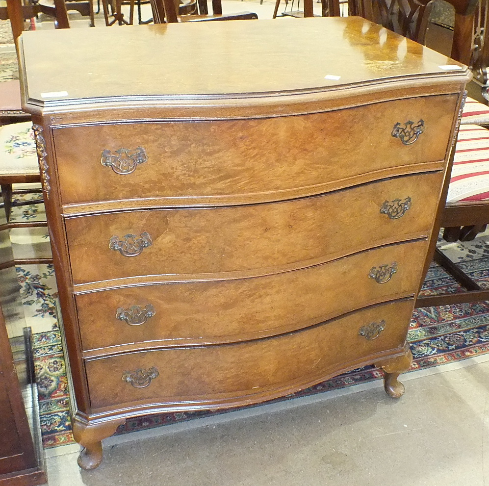 Lot 57 - A Cameo Furniture reproduction walnut shaped-front chest of four drawers, on short cabriole legs,