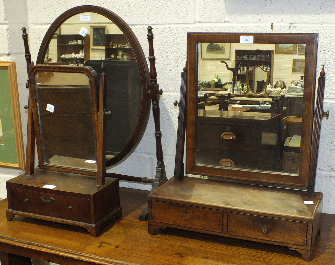 Lot 34 - A small antique walnut dressing table mirror, the rectangular plate above a base drawer, on
