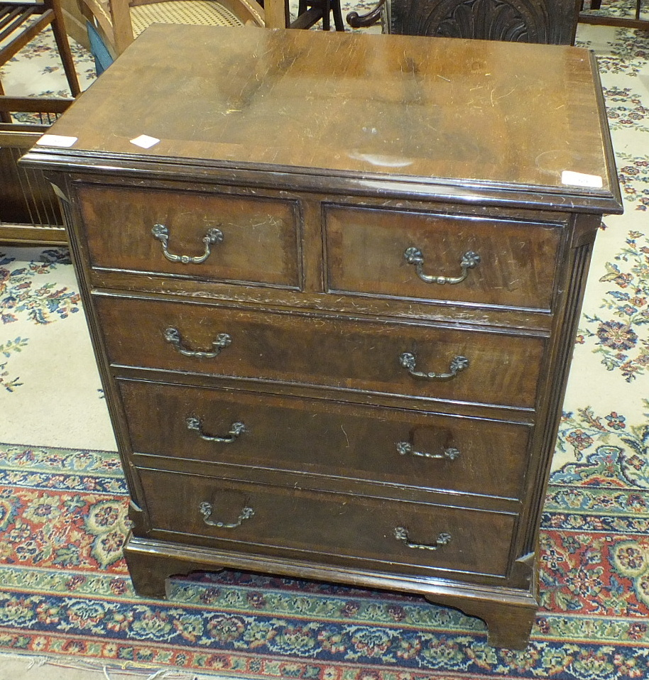 Lot 59 - A Williams & Cox, Torquay, small reproduction walnut straight-front chest of two short and three