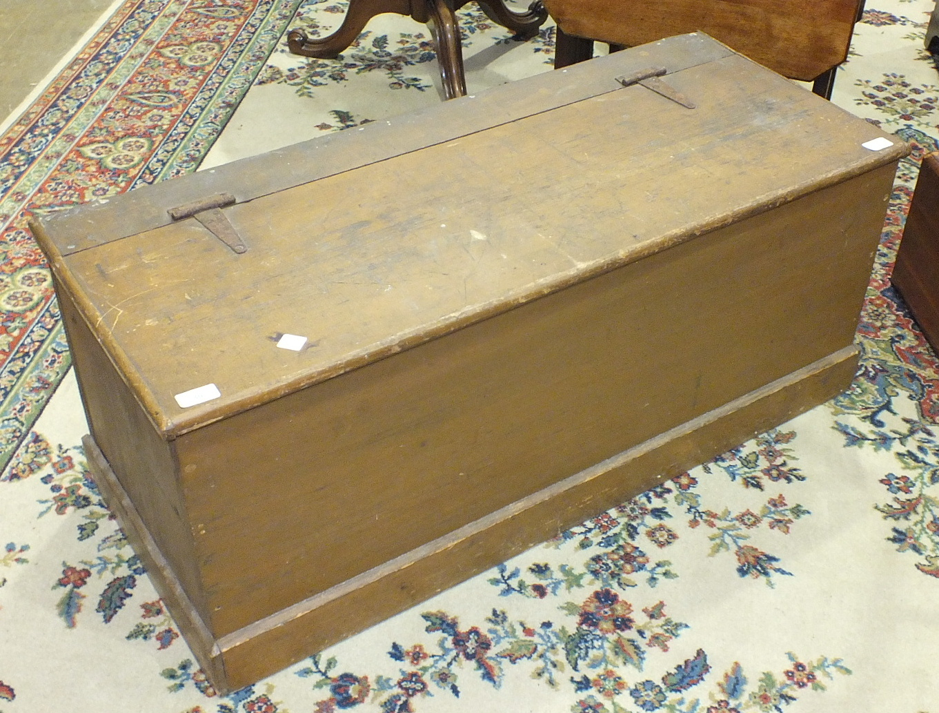 Lot 30 - A stained pine chest, 101cm wide.