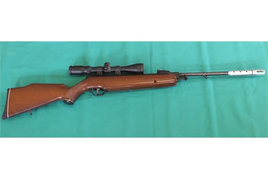 A Webley Omega  22 air rifle with scope and moderator