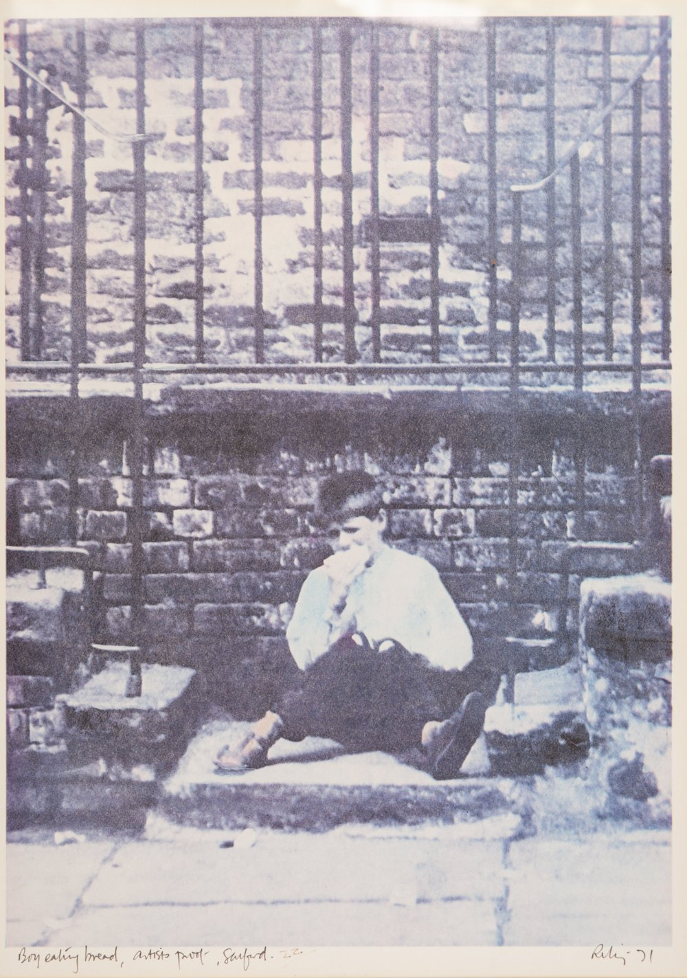 Lot 125 - •HAROLD RILEY (1934) ARTIST SIGNED PROOF PHOTOGRAPHIC PRINT 'Boy eating bread, Salford' Signed,