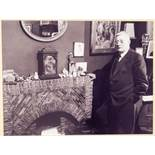 L.S. LOWRY BY MAURICE ROWE TEN BLACK AND WHITE PHOTOGRAPHS FEATURING LOWRY AND ONE OF SALFORD MARKET