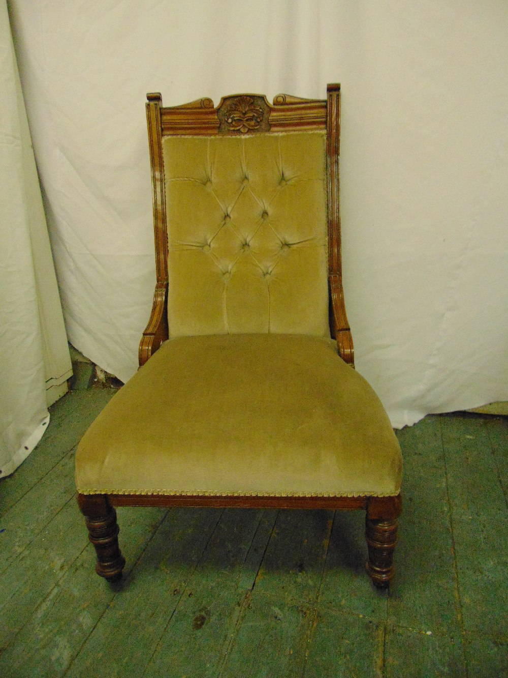 Lot 39 - A Victorian mahogany upholstered button back chair on turned legs and original castors
