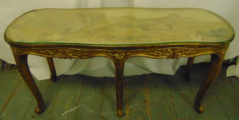 Lot 46 - A salon table rounded rectangular carved gilt wood sides and cabriole legs with tapestry top