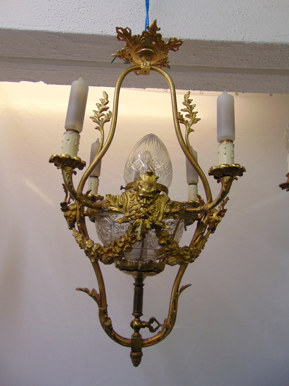 Lot 58 - A Victorian gilded metal four branch chandelier with cut glass central bowl