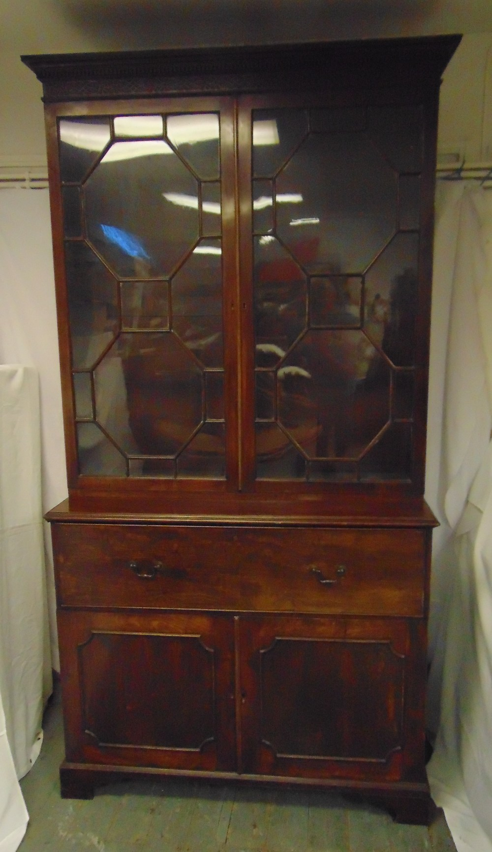 Lot 3 - A 19th century rectangular mahogany secretaire bookcase, with hinged glazed doors above four drawers