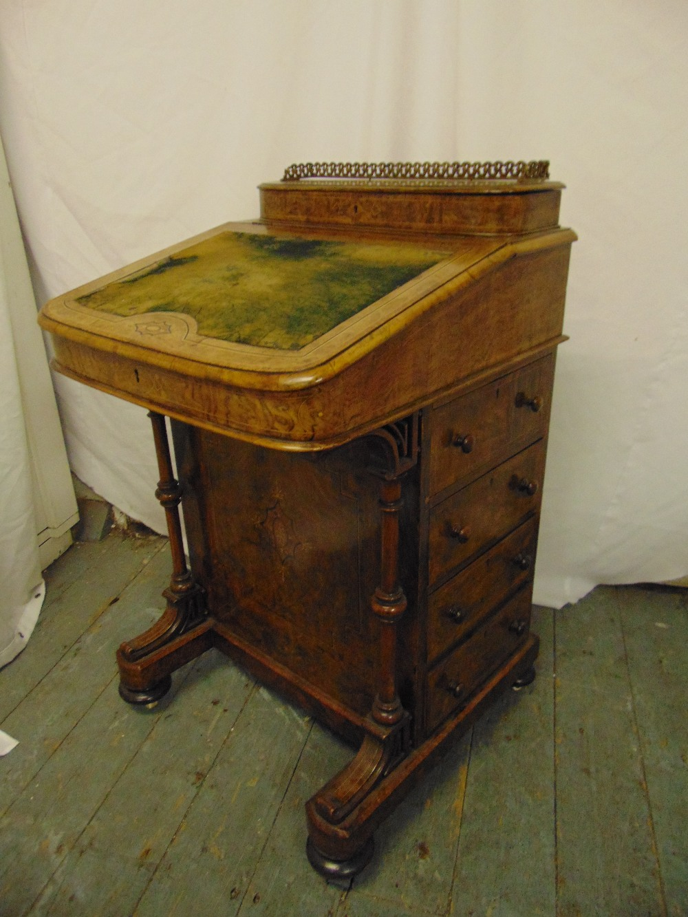 Lot 6 - A Victorian walnut Davenport, rectangular inlaid with pierced brass gallery, four drawers to one