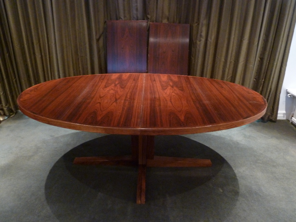 Lot 34 - Doumas Danish rosewood oval pedestal dining table with two drop in inserts, CITES certificate