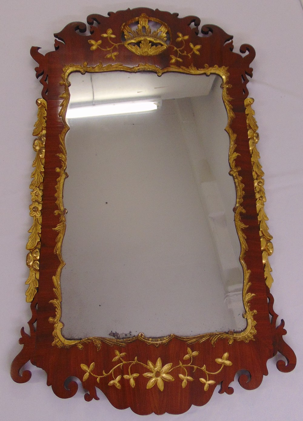 Lot 53 - A Regency style rectangular mahogany and gilt carved fretwork wall mirror, 120 x 69cm