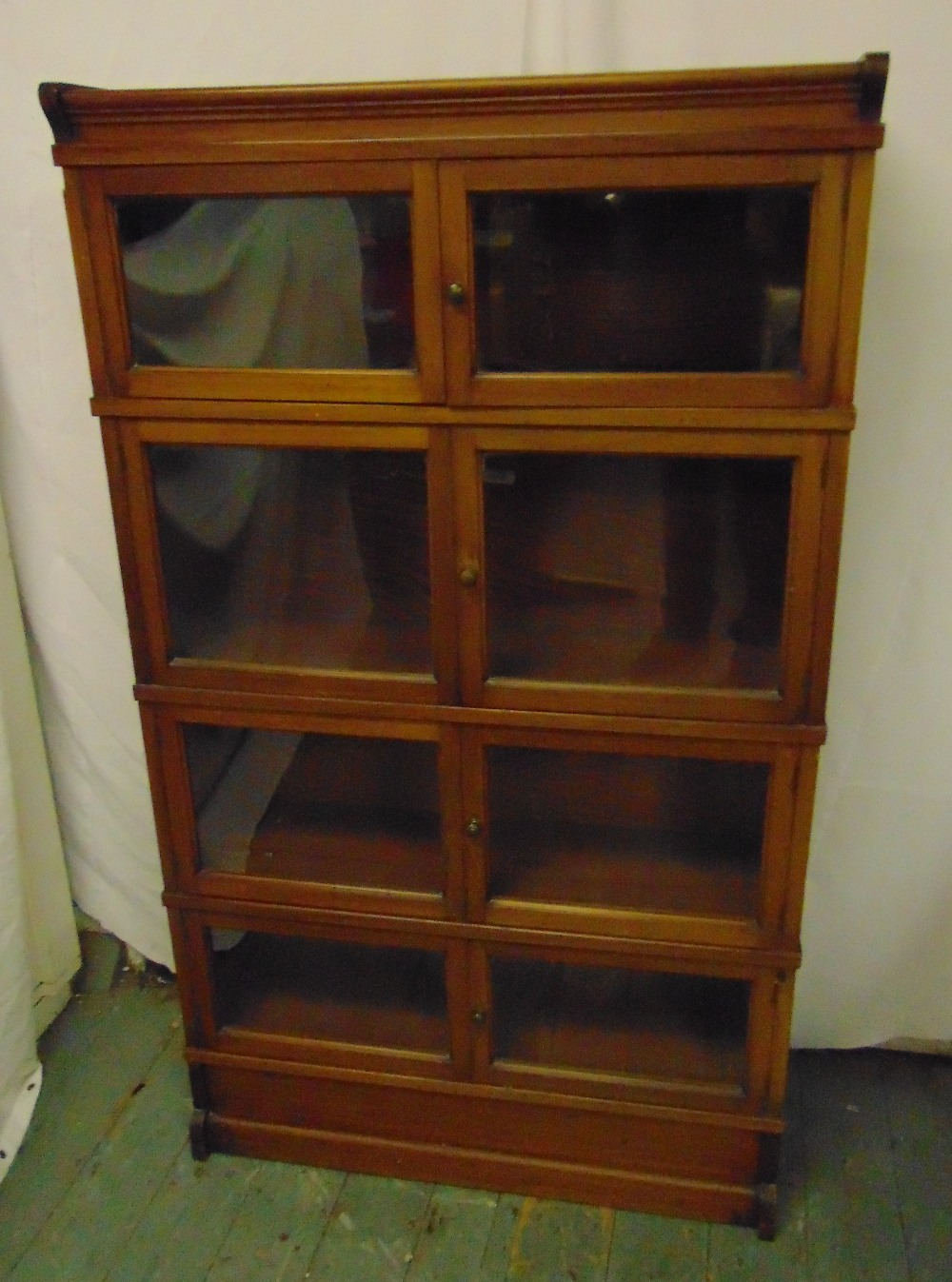 Lot 2 - An early 20th century Globe Wernicke style mahogany glazed bookcase by Simpoles of Manchester and