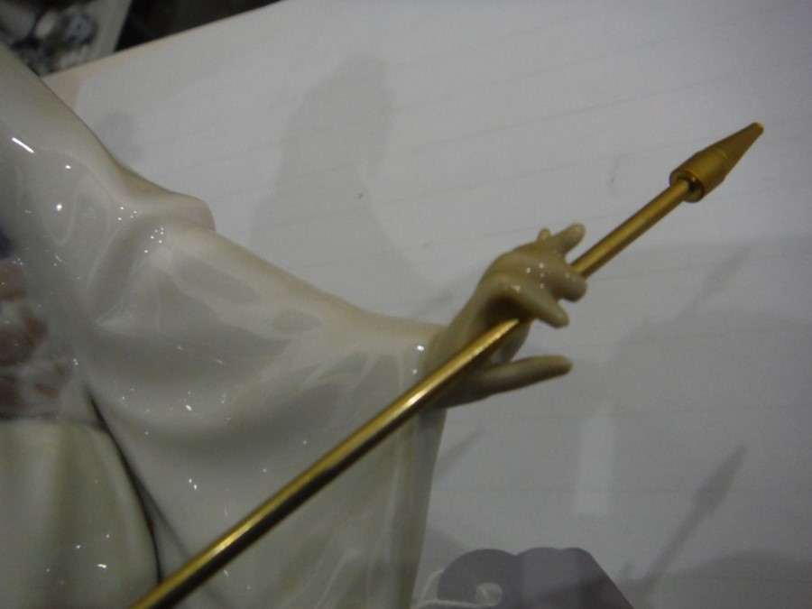 Lot 47 - Lladro standing figure of a geisha with parasol and flowering branch, on integral square base,
