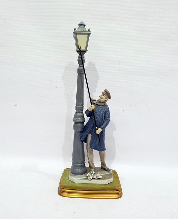 Lot 34 - Lladro figure 'The Lamplighter', on rectangular base, 48cm high