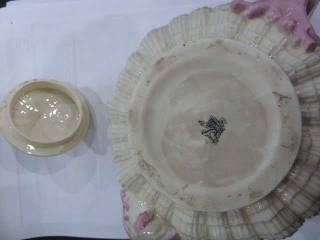 Lot 54 - Victorian Belleek teapotof circular shell design, the handle knop and spout modelled as coral, with
