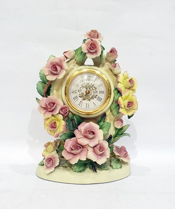 "Lot 26 - ""The Capodimonte Roses of Romance"" clock, the case decorated with yellow and pink roses, 27cm high"
