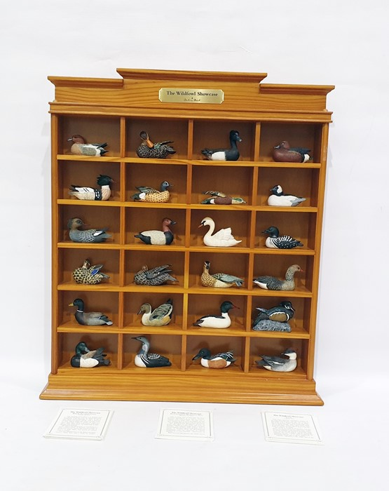 Lot 33 - The Wildfowl Showcase by Danbury Mint, comprising 24 models of different birds, in display case