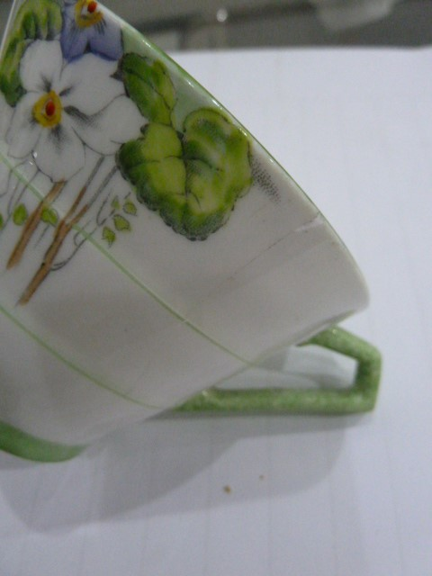Lot 28 - Art Deco Paragon tea setof ribbed conical form with painted decoration of violets, comprising