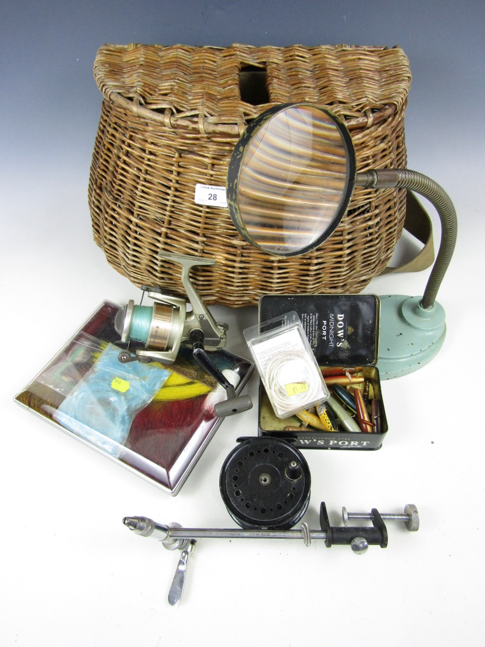 Lot 28 - A fishing creel including a Daiwa Jupiter Z reel together with a magnifying glass etc