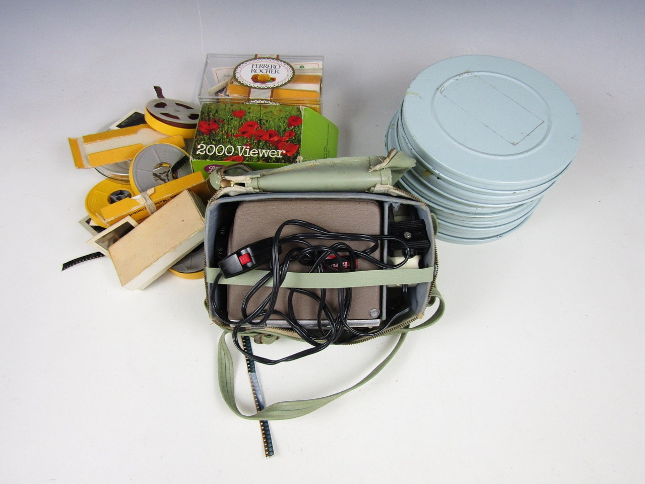 Lot 31 - A Minolta Mini 44 cased projector with tin cased reels together with a Boots viewer and slides