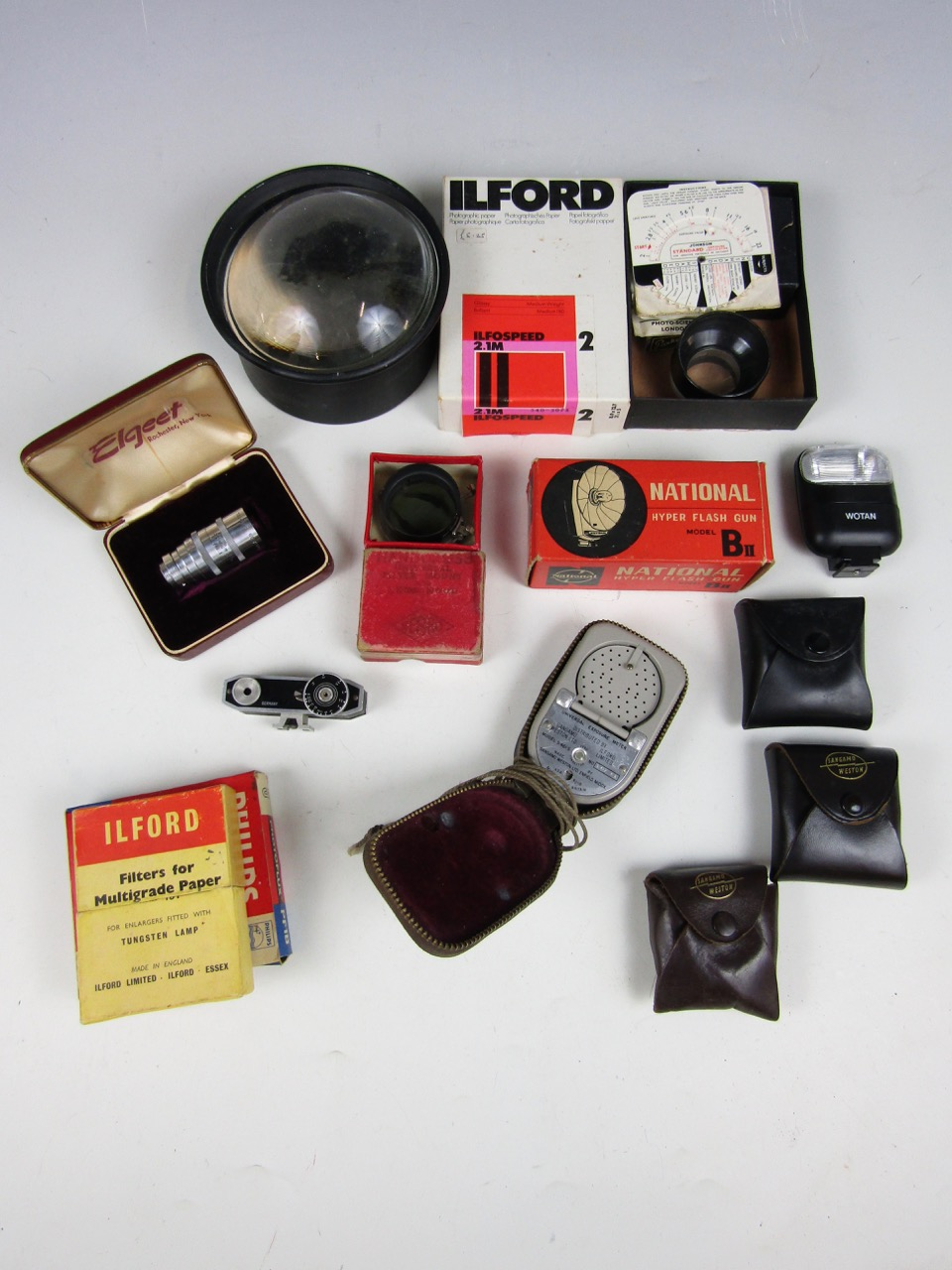 Lot 36 - A quantity of vintage camera accessories including an Elgeet Cine Tel 38 mm F.3.5 lens, boxed, a