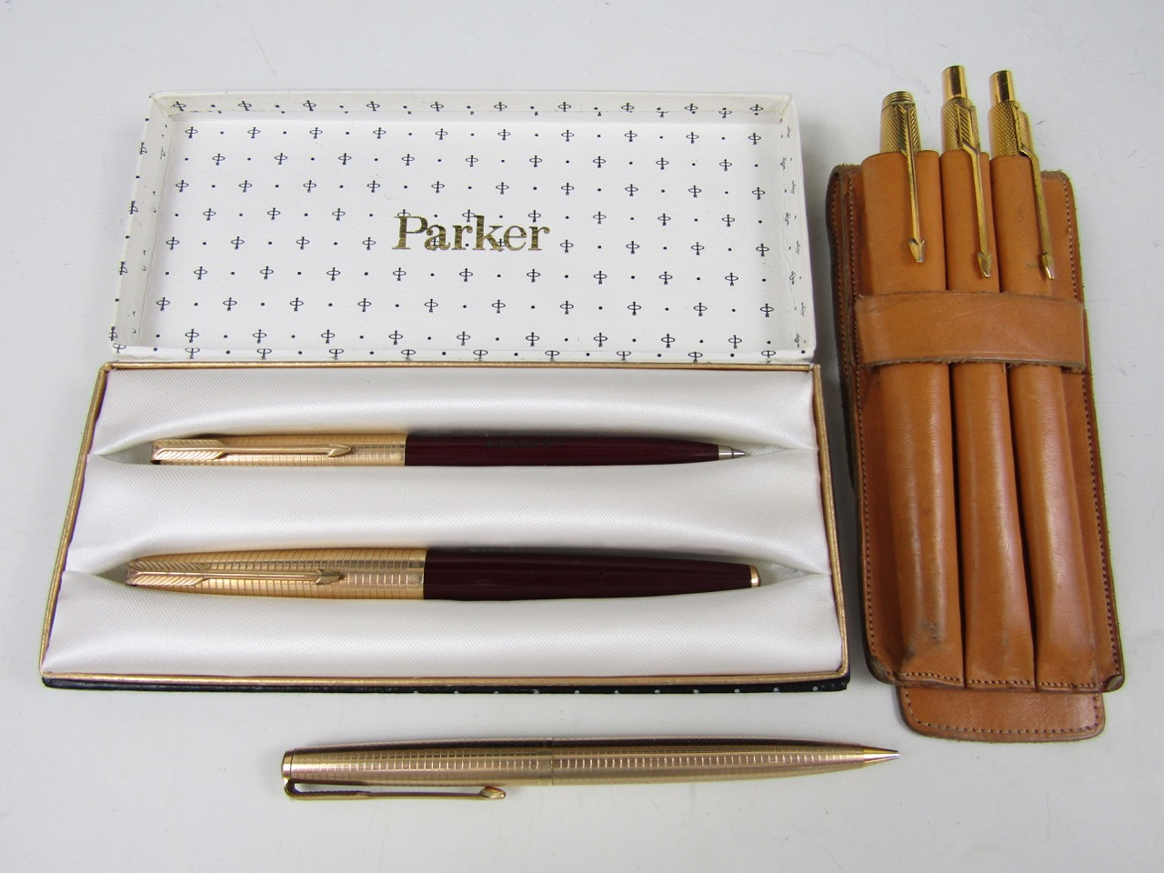 Lot 1 - A cased 1960s Parker rolled-gold fountain and ball-point pen set, together with a similar set and