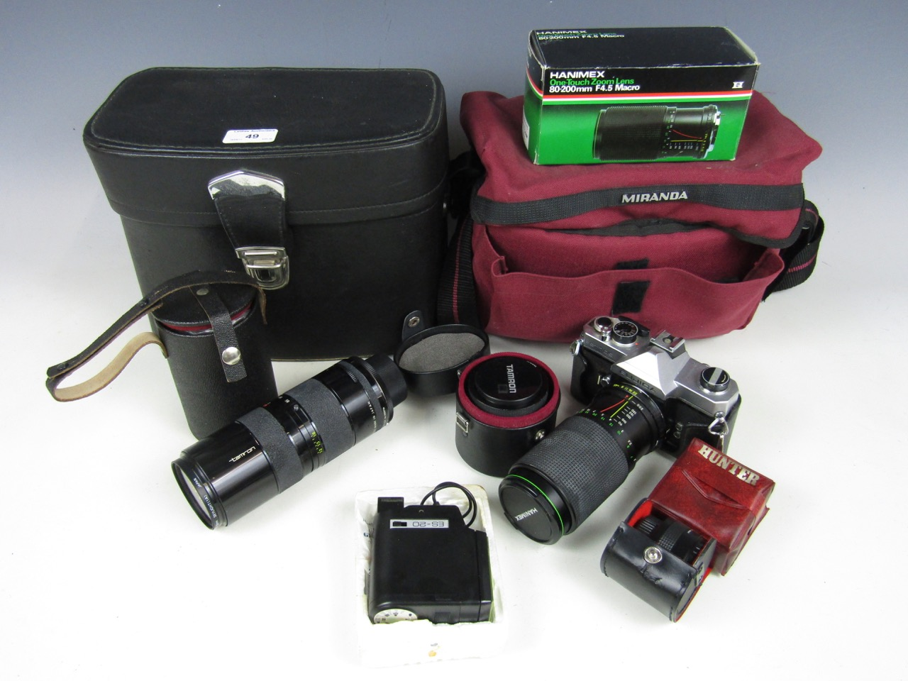 Lot 49 - A quantity of camera equipment including a Tameron camera lens, a Yashica ES20 flash, a Carl Zeiss