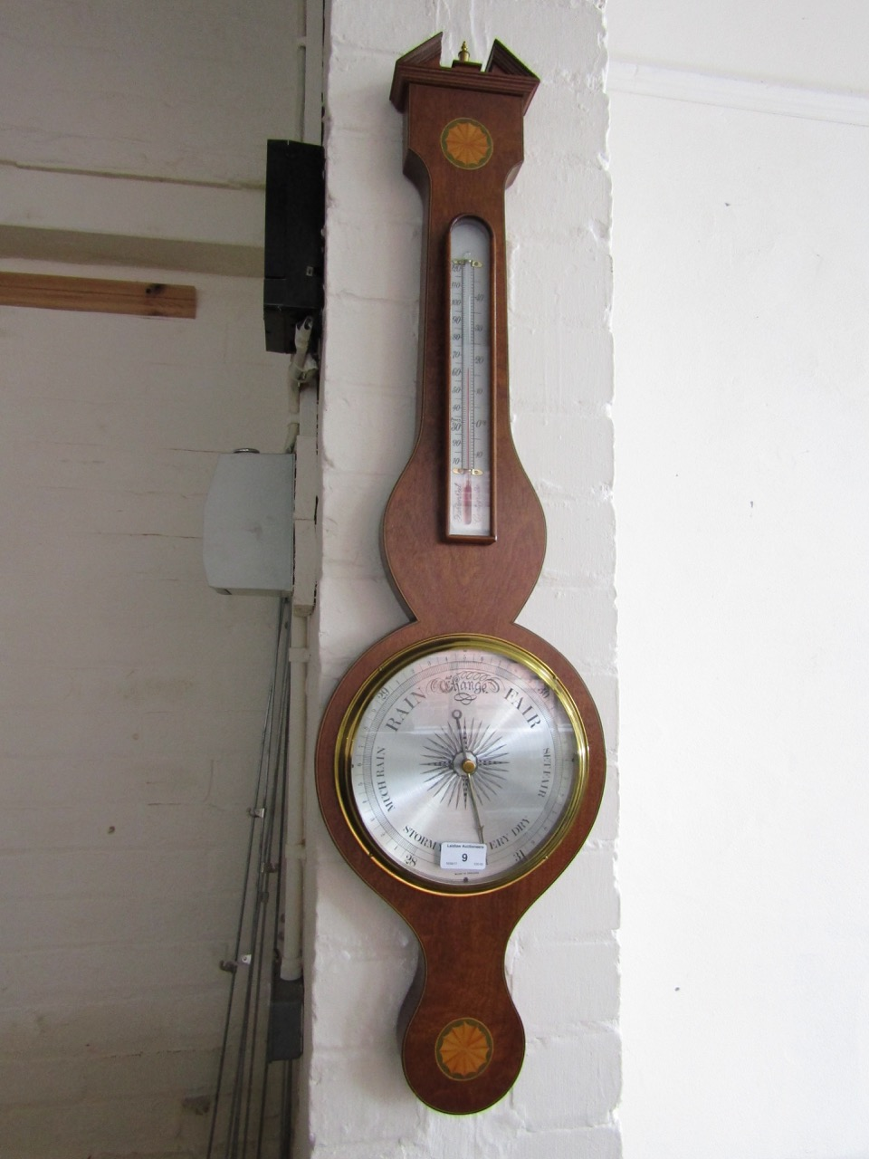 Lot 9 - A quality reproduction banjo barometer