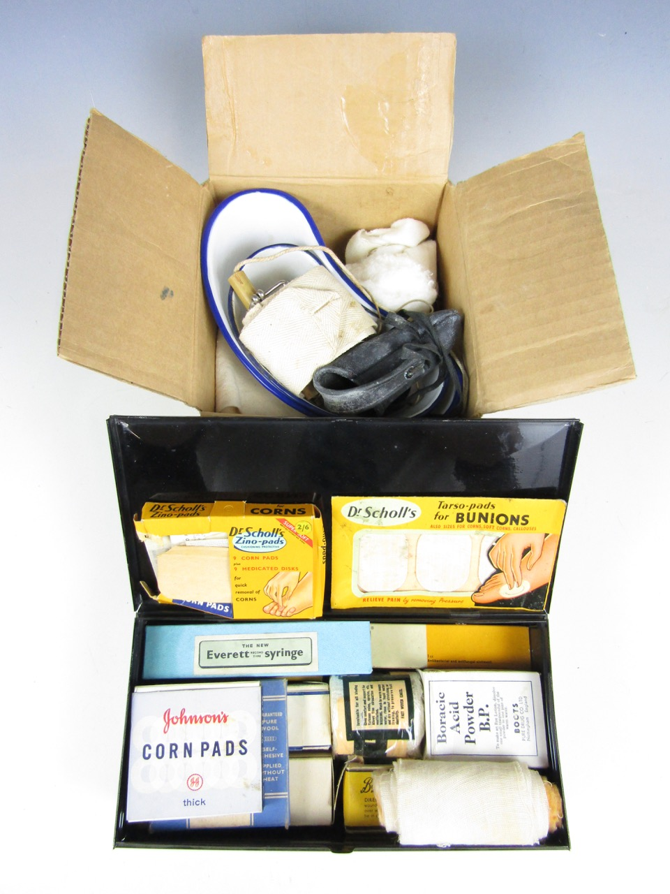 Lot 24 - A vintage Boots first aid tin with contents together with quantity of vintage bandages and enamelled