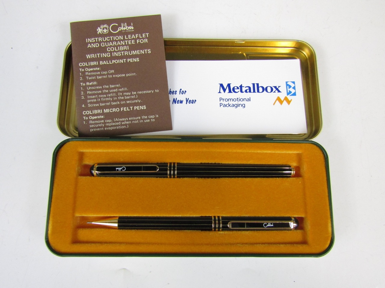 Lot 38 - A vintage Christmas special edition Colibri pen and pencil set from Metal Box of Carlisle