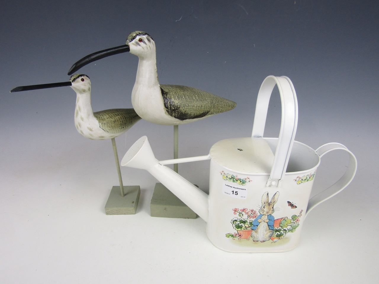 Lot 15 - A Border Fine Arts Peter Rabbit A22090 watering can together with two contemporary wooden bird