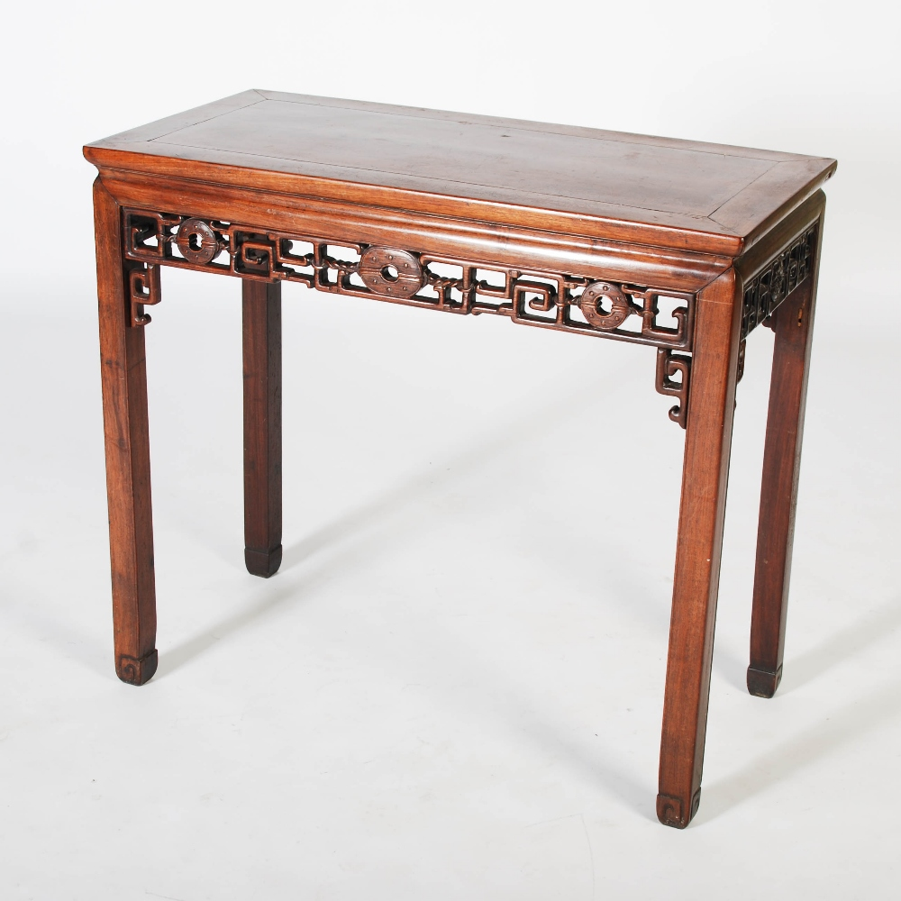 Lot 88 - A Chinese dark wood table, Qing Dynasty, the rectangular panelled top above a frieze carved with