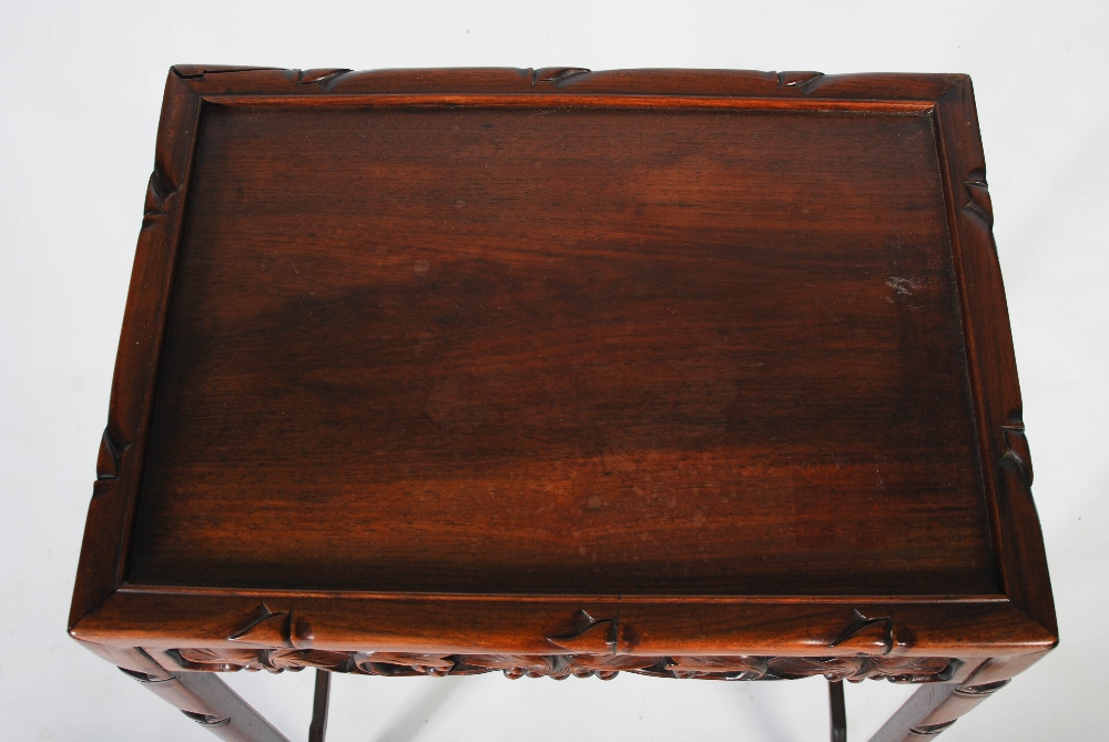 Lot 33 - A quartetto of Chinese dark wood occasional tables, Qing Dynasty, the rectangular panelled tops