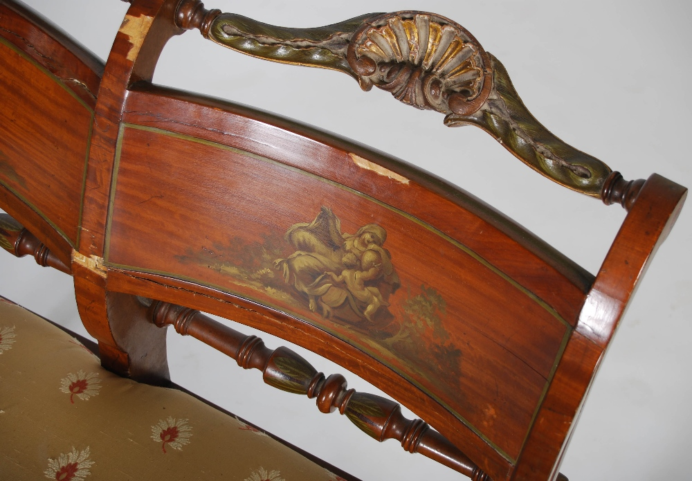 Lot 17 - A pair of painted satinwood double chair back Regency style settles, the concave rectangular backs