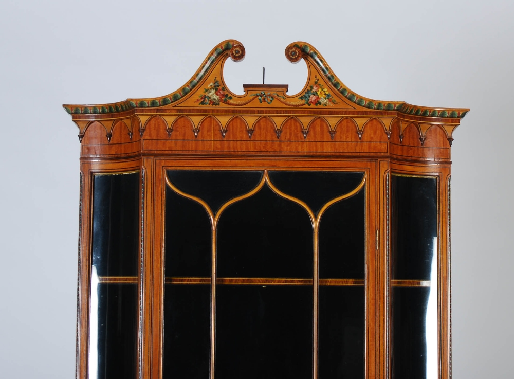 Lot 19 - A 19th century painted satinwood display cabinet, the associated top with a broken scroll pediment