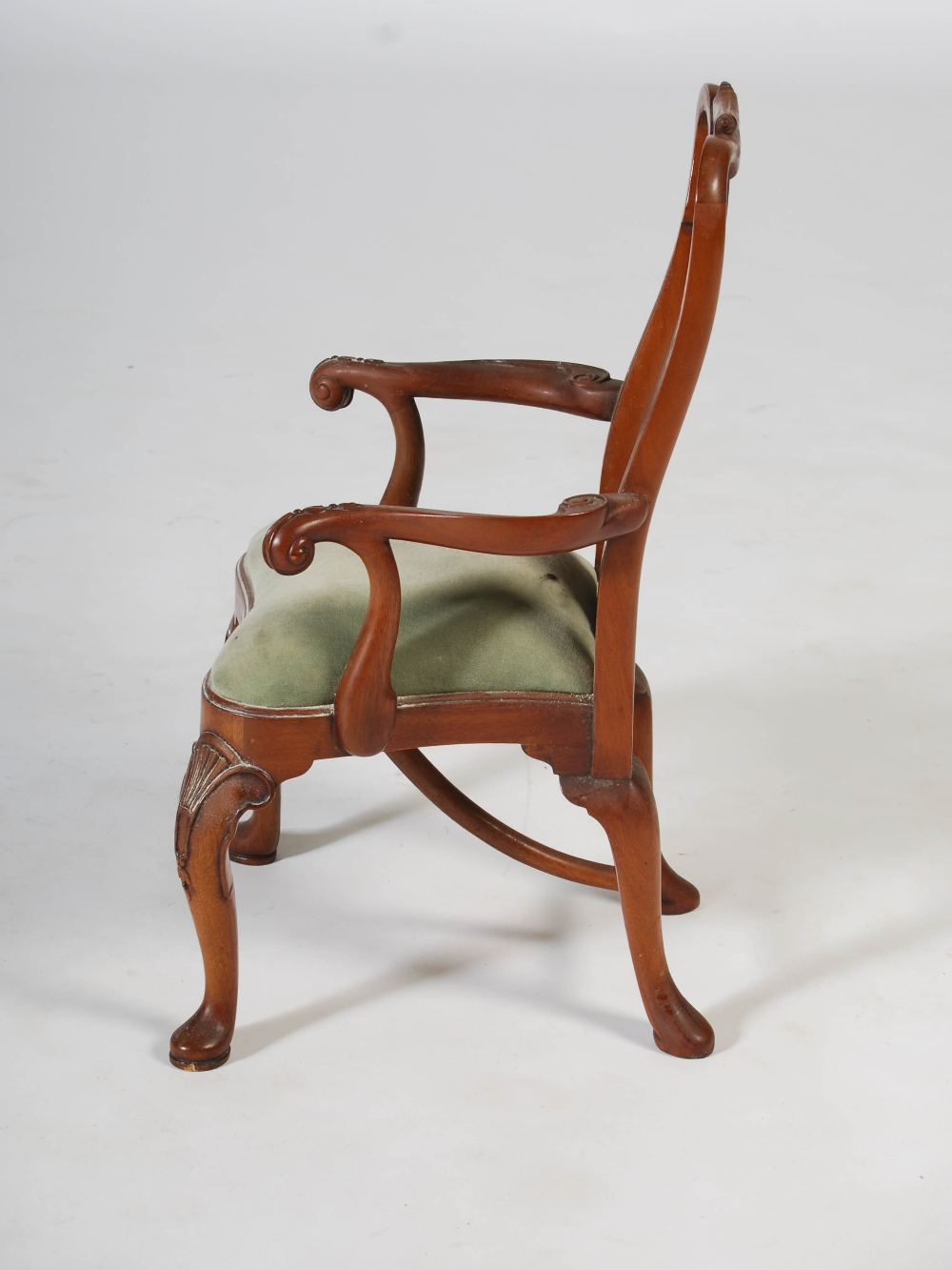 Lot 111 - A 20th century mahogany miniature George III style elbow chair, with green velvet upholstered