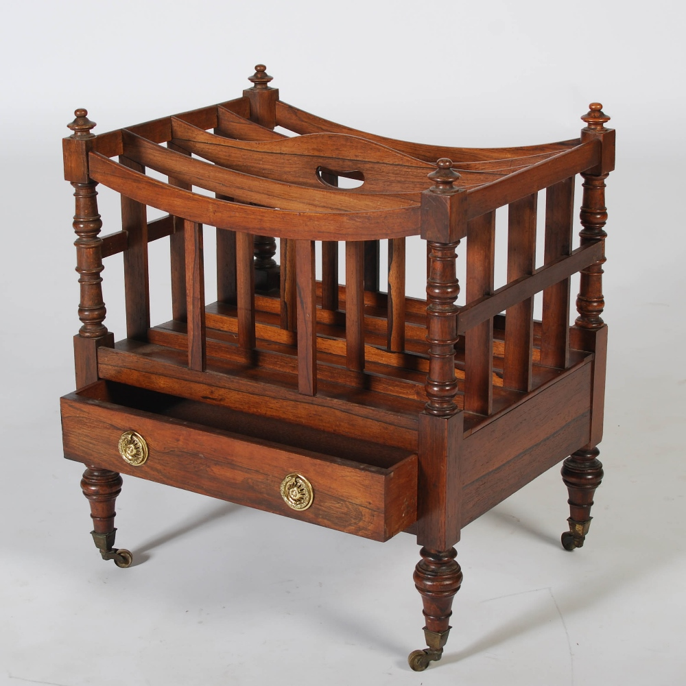 Lot 51 - A 19th century rosewood Canterbury, the rectangular top with four divisions above a single frieze
