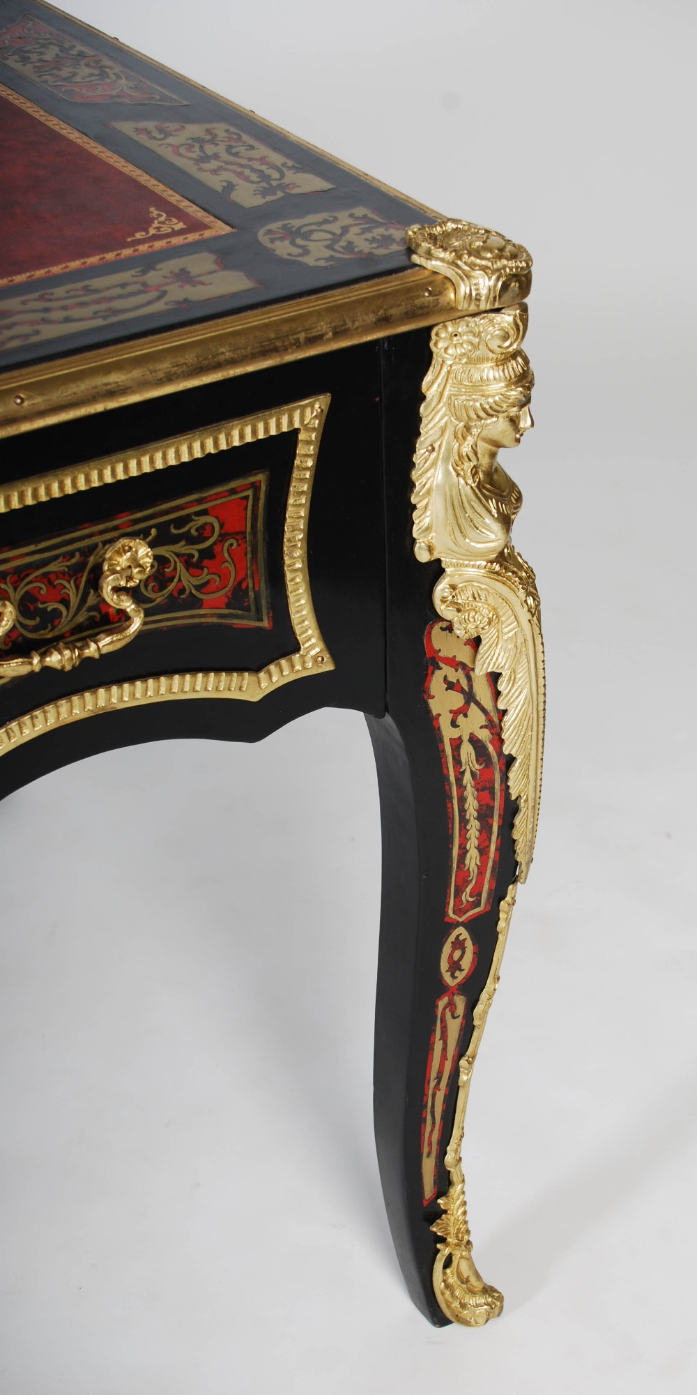 Lot 91 - A French ebonised and gilt metal mounted boulle work bureau plat, the rectangular top with red