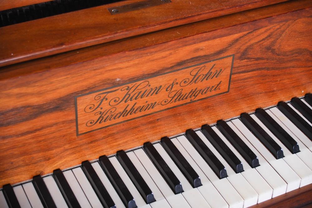 Lot 10 - A walnut cased boudoir grand piano, F. Kaim & Shone, Kirchheim, Stuttgart, raised on tapered