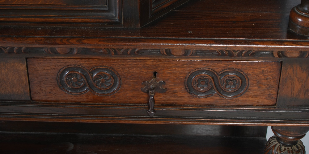 Lot 59 - A 17th century style oak court cupboard, the rectangular top above a marquetry inlaid cupboard