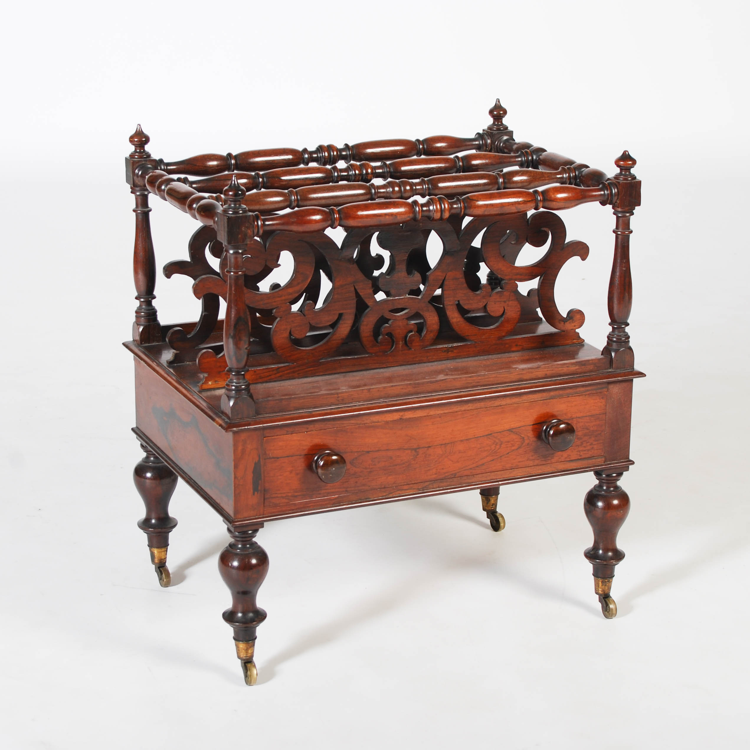 Lot 39 - A 19th century rosewood Canterbury, the rectangular top with four turned divisions above a single