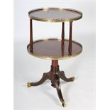 Lot 38 - A late 19th century mahogany and gilt metal mounted two tier revolving dumb waiter, the upper tier