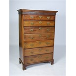 Lot 117 - A George III mahogany and later secretaire tall chest, the moulded cornice and blind fret work