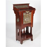 Lot 61 - An early 20th century Arts & Crafts mahogany, white metal and copper mounted music cabinet, the