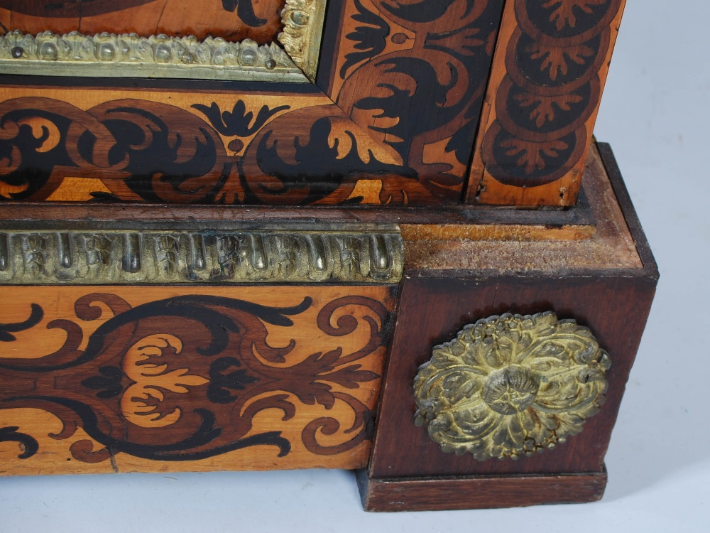 Lot 100 - A pair of 19th century Continental marquetry inlaid and ormolu mounted pier cabinets, the mottled