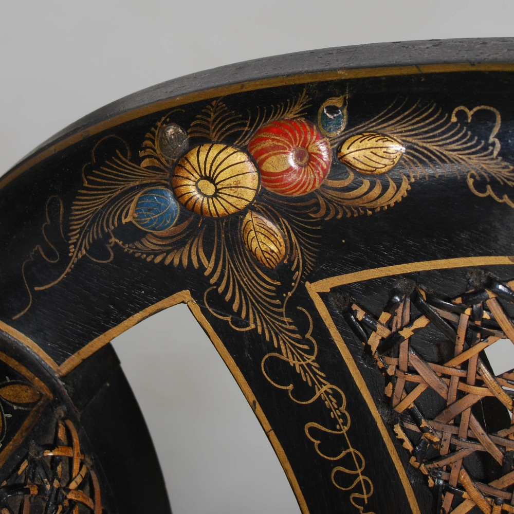 Lot 79 - An early 20th century black lacquer chinoiserie decorated three piece Bergere suite, comprising;